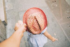 Toddler girl walking holding mother's hand - GEMF02116