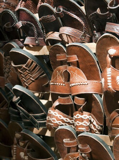 Leather slippers and sandals for sale in the shops of the medina in Fes, Morocco - CUF41034