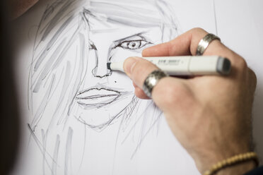 Close-up of artist drawing a sketch - ZEF15860