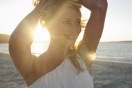 Close up of blond woman on beach at dusk, Cape Town, South Africa - CUF41324