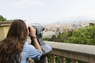 Young female tourist looking at view of Barcelona, Spain - CUF41333