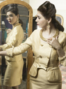 Woman in vintage clothes looking in mirror - CUF41345