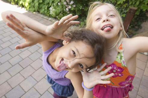 Two girls pulling faces - CUF41480