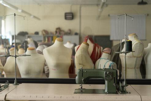 Dressmaker's models and sewing machine in fashion designer's studio - AFVF00757