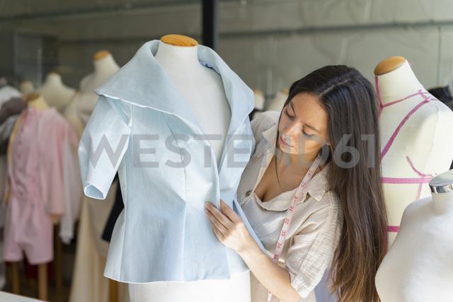 Young fashion designer fitting clothes on dressmaker's model - AFVF00763