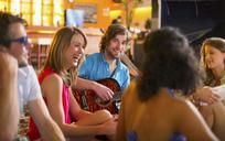 Friends enjoying guitar playing in bar - CUF41514