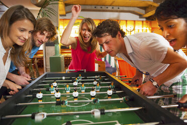 Group of friends playing table football - CUF41520