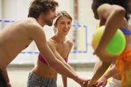 Friends having team talk at indoor beach volleyball - CUF41526