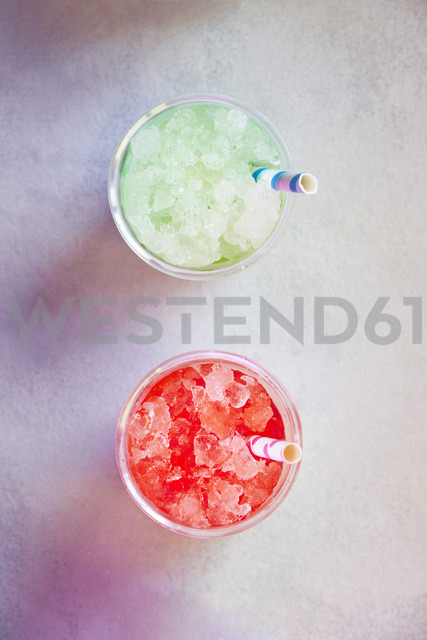 Two plastic cups of pineapple and watermelon slush - BZF00416