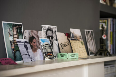 Living room mantelpiece with travel souvenirs and photographs - CUF41596