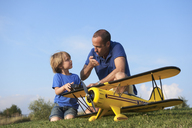 Father and son preparing model plane - CUF41662