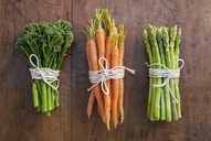 Bunches of carrots, broccoli and asparagus tied with string, still life - CUF41717