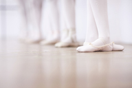 Close up of teenage ballerinas feet poise - CUF41894