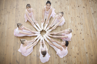 Elevated view of young ballerina in circle formation - CUF41921