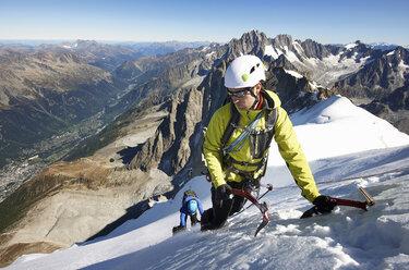 Mid adult couple mountaineering, Chamonix, Haute Savoie, France - CUF42368