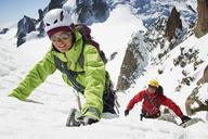 Two people mountain climbing, Chamonix, France - CUF42395
