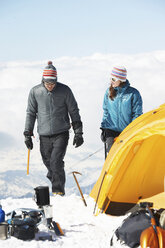 Mid adult couple by tent, Chamonix, France - CUF42401
