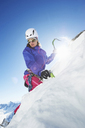 Female mountain climber using ice pick - CUF42422
