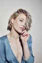 Portrait of beautiful blond woman wearing evening dress - PNEF00727