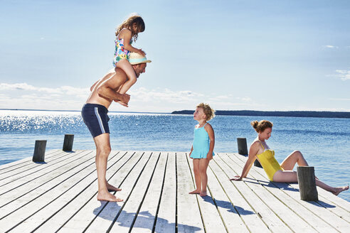 Parents and two young girls on pier, Utvalnas, Gavle, Sweden - CUF42673