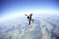 Female skydiver free falling above Leutkirch, Bavaria, Germany - CUF42700