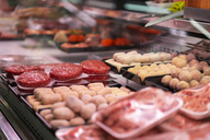 Meat products on display at a meat counter - AFVF00771