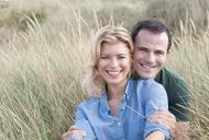 Portrait of mid adult couple in sandunes, Thurlestone, Devon, UK - CUF42810