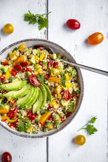 Bowl of bulgur salad with bell pepper, tomatoes, avocado, spring onion and parsley - SARF03831