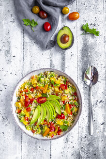 Bowl of bulgur salad with bell pepper, tomatoes, avocado, spring onion and parsley - SARF03834