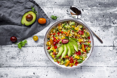 Bowl of bulgur salad with bell pepper, tomatoes, avocado, spring onion and parsley - SARF03837