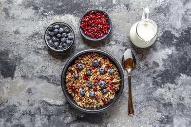 Bowl of muesli with blueberries and pomegranate seed - SARF03840