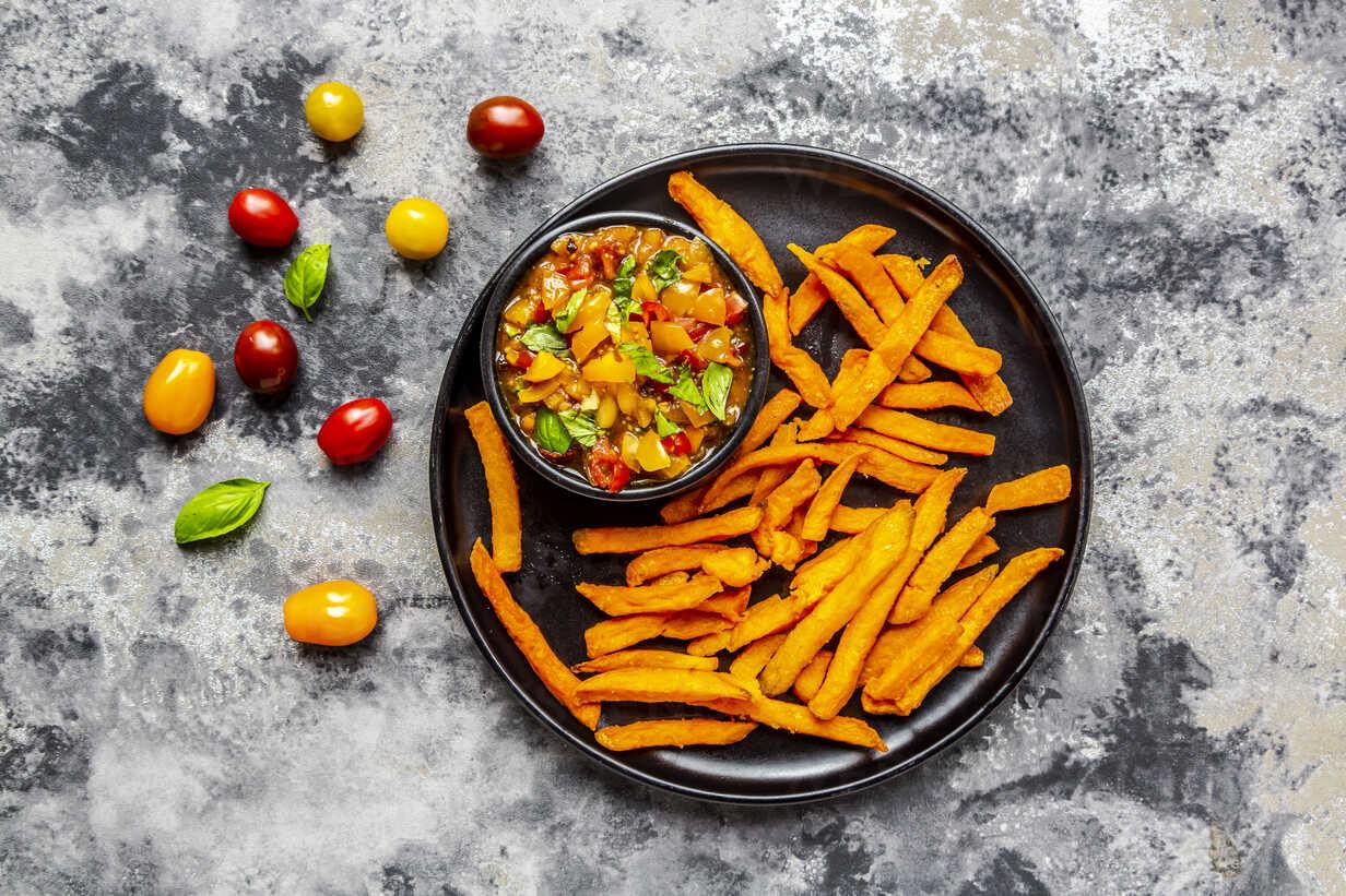 Homemade sweet potato fries and bowl of tomato basil dip - SARF03846 - Sandra Roesch/Westend61