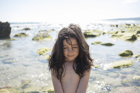 Little girl with eyes closed at the beach, feeling the wind - JASF01897