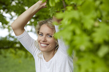 Portrait of relaxed blond woman in nature - PNEF00763