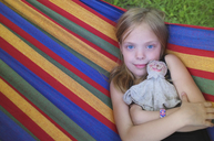 Portrait of young girl in hammock - CUF42933