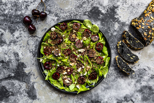 Lamb's lettuce with cherries, feta cheese, roasted sesame and black sepia spelt bread - SARF03852