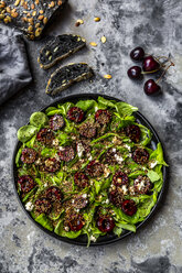 Lamb's lettuce with cherries, feta cheese, roasted sesame and black sepia spelt bread - SARF03855