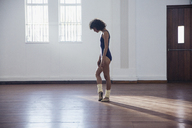 Graceful young female dancer practicing in dance studio - HOXF03632