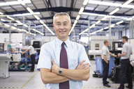 Portrait of manager in engineering factory - CUF43396