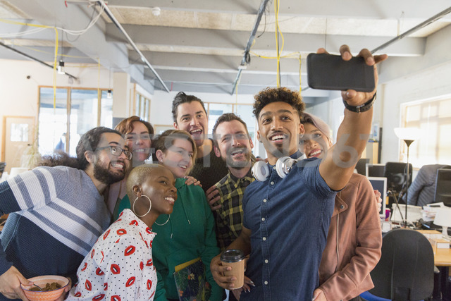 Creative business team taking selfie in office - CAIF21013
