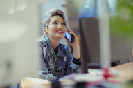 Creative businesswoman talking on smart phone - CAIF21100
