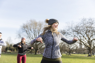 Woman exercising in sunny park - CAIF21166