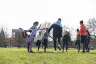 People exercising, stretching in sunny park - CAIF21169