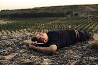 Young man lying on rock, sleeping - ACPF00140