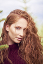 Portrait of redheaded young woman with freckles - ABIF00703