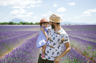 France, Provence, Valensole plateau, happy father and daughter in lavender fields in the summer - GEMF02126