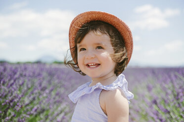 France, Provence, Valensole plateau, Happy toddler girl in purple lavender fields in the summer - GEMF02135