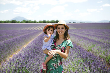 France, Provence, Valensole plateau, portrait of smiling mother and daughter in lavender fields in the summer - GEMF02144