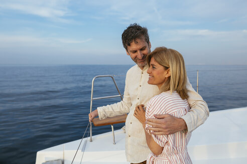 Mature couple enjoying quality time on sailing trip on a catamaran - EBSF02618