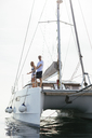 Mature couple making holidays, sailing on a catamaran - EBSF02666
